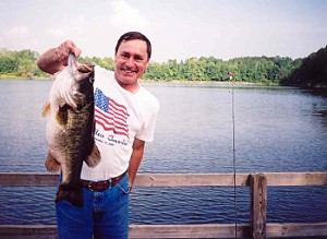 Randal Cowart with his 14 lb 1 oz bass from Lake Ely